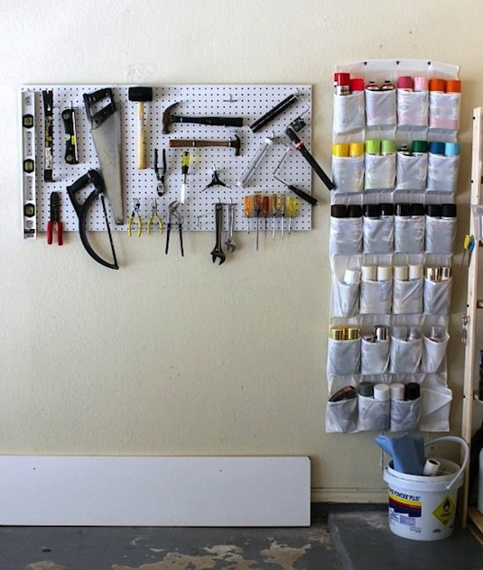 28 Brilliant Garage Organization Ideas | Use a hanging shoe rack in your garage to keep organized.